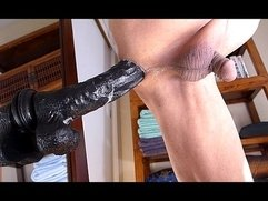 Man masturbating anal with big black dildo and lot of cums.