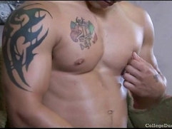 Here is a sexy college hunk with tattooes and muscles masturbating