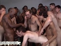 Twink loves getting gangbanged in this bukkake session