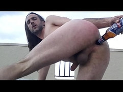 buttslut gringocaliente gregory morelia naked fucks own ass with beer bottle on public hotel rooftop in florida usa